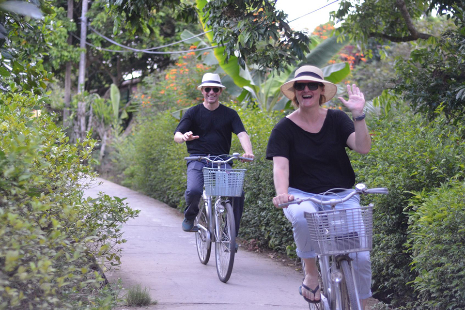 biking-around-village-cai-be-floating-market-tan-phong-island-full-day-group-tour-1