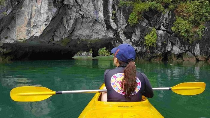 kayaking to explore Dark and Bright Cave
