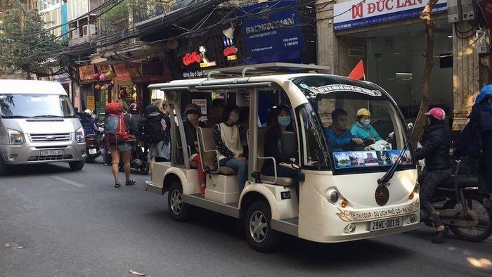 Explore Hanoi by electric car