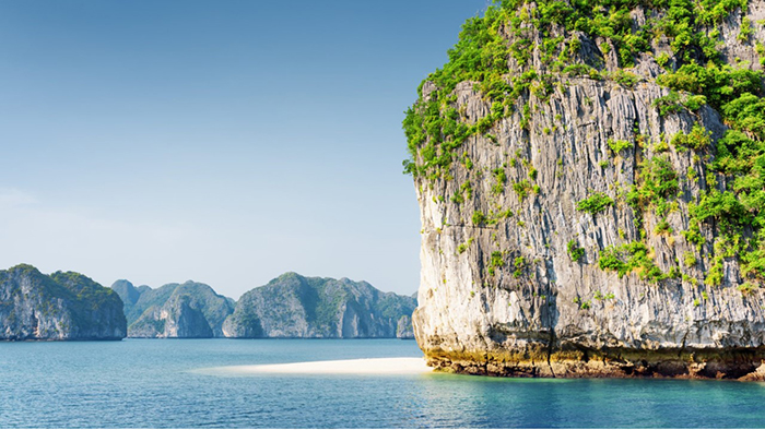 The clear sea water with white sand in Halong Bay