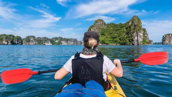 Kayaking on a Halong Bay cruise tour