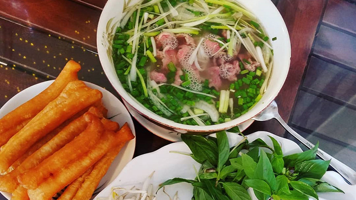 Rice noodle soup with beef - the must-try specialty in Vietnam