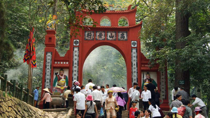 Vietnamese people going to attend Hung Kings Temple Festival