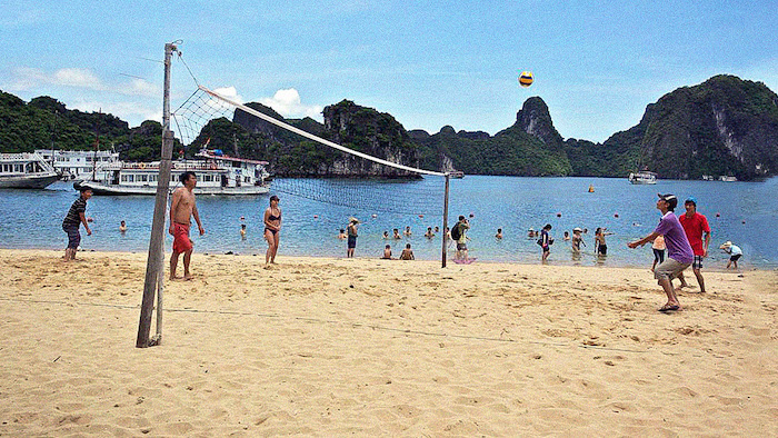 Playing volleyball in Halong Bay