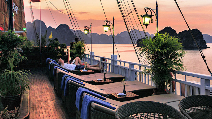 Admiring the beautiful sunset on Halong Bay cruises