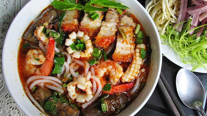 The seafood noodle with the fish fermented broth