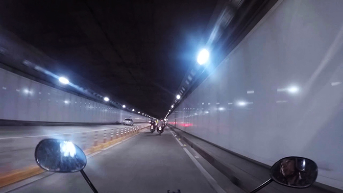 Driving a motorbike in Thu Thiem tunnel