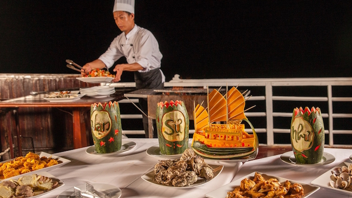 Seafood barbecue is one attraction of Halong cruise tour