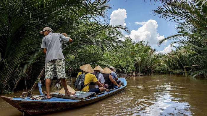 Visiting the Mekong Delta canals on boats